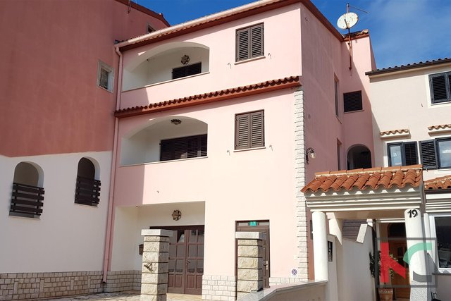 Pula, Veruda Porat is an interesting property near the sea with three residential units and a business unit